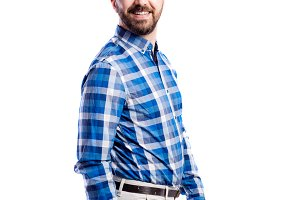 Hipster man in checked blue shirt, studio shot, isolated.