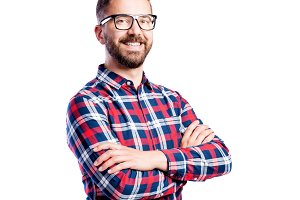 Hipster man in checked shirt, studio shot, isolated