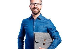 Hipster man in blue denim shirt, studio shot, isolated