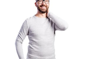 Hipster man in white long-sleeved t-shirt. Studio shot, isolated