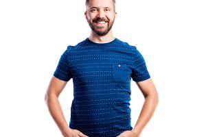 Hipster man in blue t-shirt, studio shot, isolated