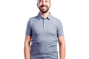 Hipster man in gray t-shirt. Studio shot, isolated.