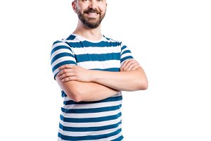 Hipster man in blue striped t-shirt, studio shot, isolated