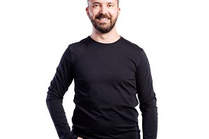 Hipster man in black long-sleeved t-shirt, studio shot, isolated
