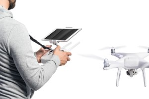 Unrecognizable man with drone. Studio shot, white background, is