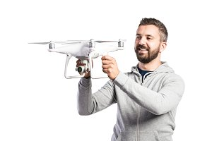 Man holding drone. Studio shot on white background, isolated