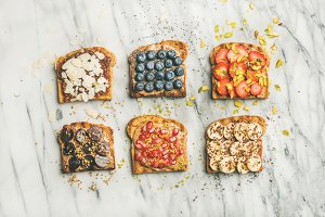 Vegan whole grain toasts with fruit, seeds, nuts, peanut butter