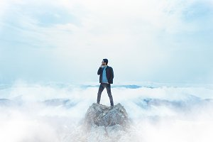Man standing on the rock on top of m
