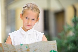 Adorable little girl enjoy italian vacation holiday in Europe.