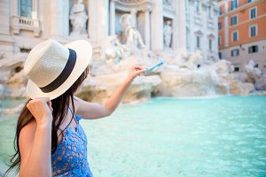 Beautiful woman near Trevi Fountain, Rome, Italy.