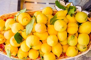 Wicker basket full of lemons on the italian street od Corniglia