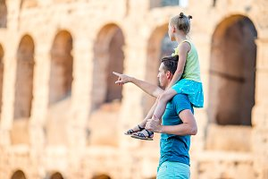 Young father and little girl background Colosseum, Rome, Italy
