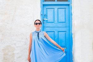 Young beautiful woman on vacation in Mykonos