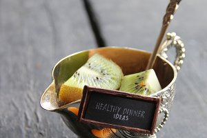 Healthy dinner ideas tag and fruits on table. Food background.