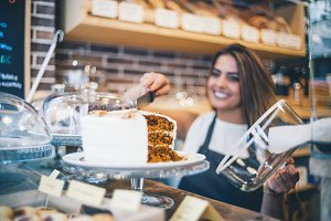 Woman works in pastry shop.