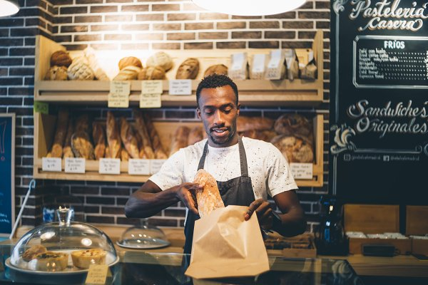 Food Stock Photos: OscarStock - Afro man works in pastry shop.