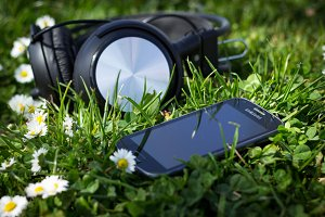 Phone and headsets in springtime