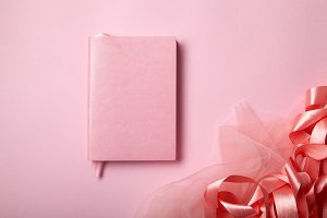 Pink notebook with shiny pink satin ribbon