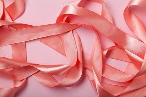 Shiny pink satin ribbon texture