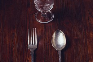 Spoon and glass on wood