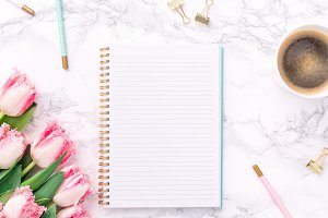 Blank notepad with tulips and coffee