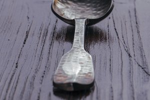 Old wooden spoon over