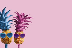 Couple pineapples on pink background