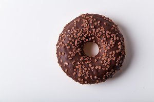 Glazed chocolate donut with sweet chocolate sprinkles