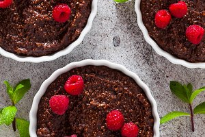 delicious chocolate desserts with nuts and fresh raspberries in