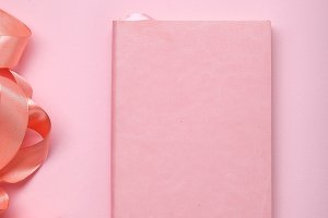 Pink notebook with shiny pink satin