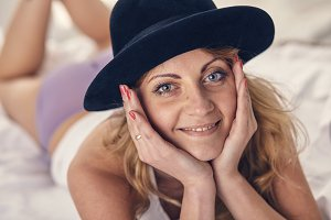 woman in the hat in the morning in bed