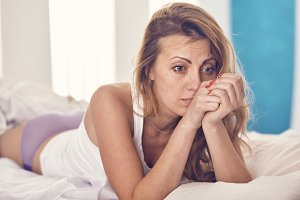 woman worries about something in the morning in the bed