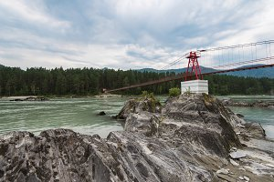 suspension bridge on mountain river