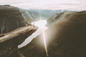 Traveler on Trolltunga cliff edge