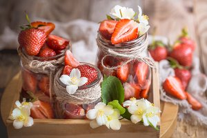 Fresh strawberries in jars