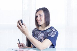 woman checking a reader
