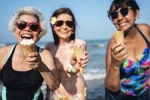 Senior friends enjoying the beach