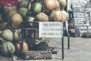 Coconuts for sale on a roadside on Bali island, Indonesia.