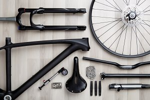 Photo of bicycle objects on wooden background.