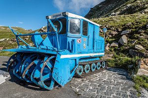 Blue snow blower in the mountain