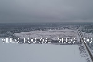 Winter road in the field.