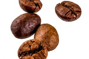 Coffee beans on white bg