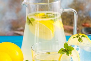 Bottle of fresh drink with lemon and