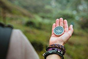 Compass in womens palm. Female explorer the mountainous terrain on Santo Antao Island. Cape Verde. Kap Verde