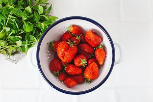 Fresh strawberries in a colander