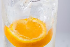 Orange fell in a glass with water
