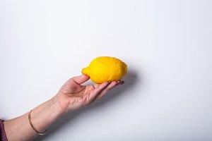 Hand holding lemon