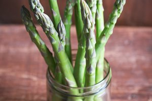Banches of fresh green asparagus in a jar