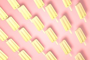 Yellow fresh sweet popsical ice cream on pastel pink background.