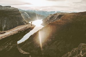 Tourist on Trolltunga cliff edge